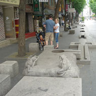 Historic character of Insadong-gil is strengthened with custom street furnishings. Source: MIG