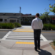 Well designed crosswalks with low plants and in-pavement flashers. Source: MIG