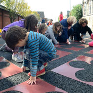 Creating a street carpet as part of Sustrans DIY Streets project to encourage drivers to drive slowly. Local residents, school children, Sustrans & Bristol City Council lay down the 'carpet'. Source: J Bewley/Sustrans